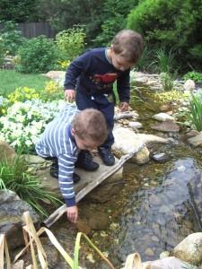Blackburn cottage garden stream with children playing