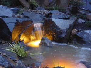 Camberwell - sheet waterfall lit up at night.
